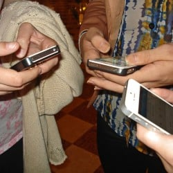 People looking at their iPhones