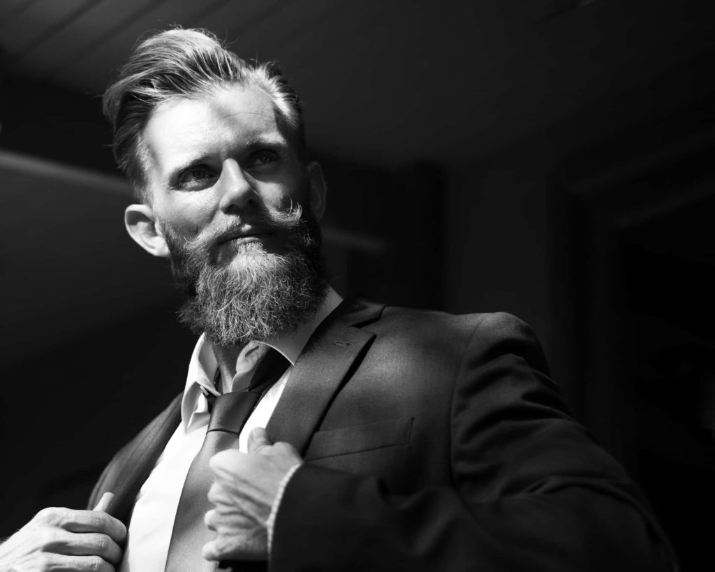 Man with beard wearing a suit and tie