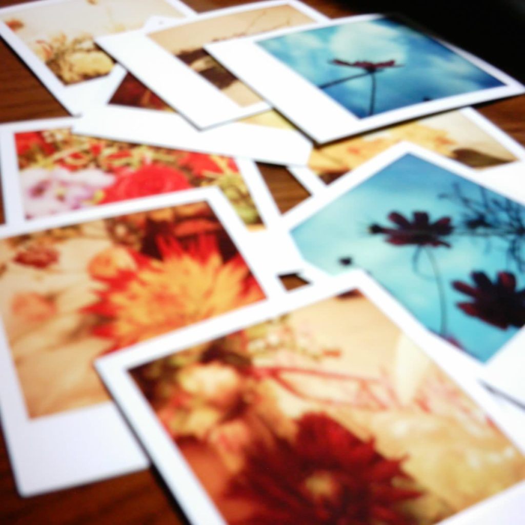 Scattered polaroids on a table