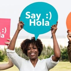 Happy woman holding speech bubble