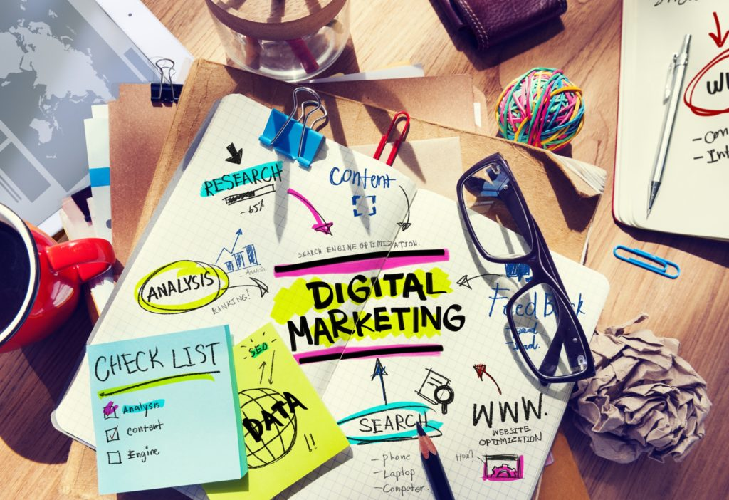 Digital marketing ideas and mindmap on a cluttered desk